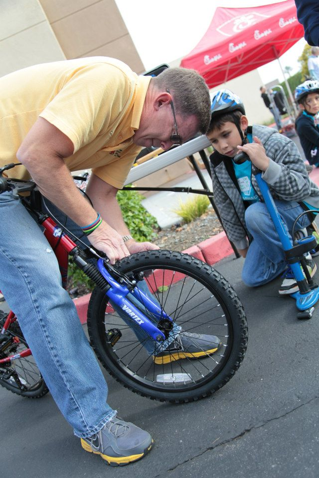 OCBC Board Secretary, Jim Freibert wrenched and adjusted bikes for kids eager to get onto those new bikes.