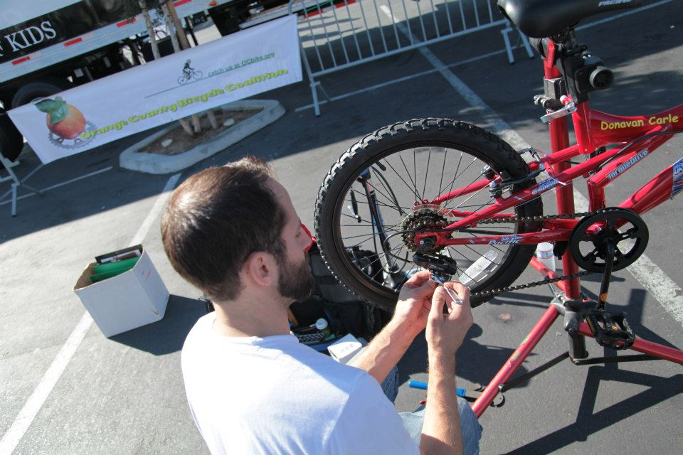 Dan from Trail's End bike shop lent his expertise to bikes assembled by kids, parents, and volunteers from GSF.