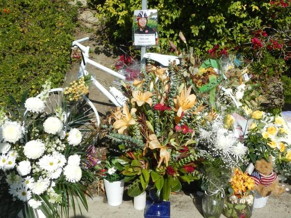 Flowers and a ghost bike in Memory of Paul Lin at the intersection of San Joaquin and Marguerite, Corona del Mar.